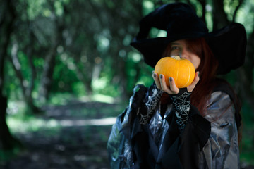 Photo of witch with pumpkin