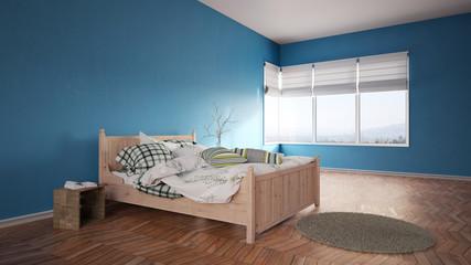 Bett im Schlafzimmer mit blauen Wänden