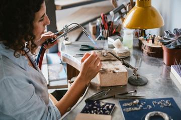 Craftswoman working with acetylene torch