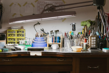 Illuminated jewellers workbench in jewellery workshop