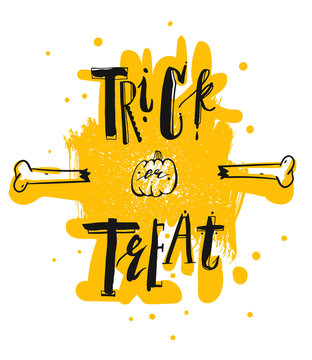 Hand drawn vector illustration with handwritten modern lettering phase trick or treat in black and yellow colors isolated on white.Halloween holiday background
