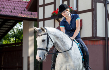 Horse rider woman near stable horsewoman before training