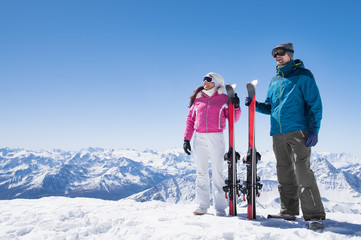 Garden Poster Winter sports Couple holding ski