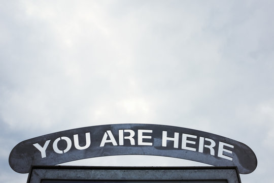 Sign over an arch You Are Here