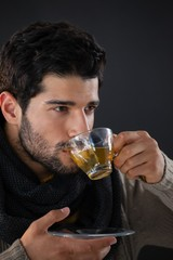 Thoughtful man having a cup of lemon tea