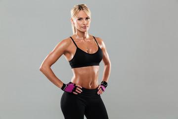 Beautiful young athlete woman posing