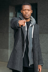 African American man pointing at someone. Black male blaming somebody, stylish clothes, hand gesture, accusation concept