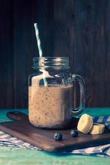 Photo of mug with milkshake with straw