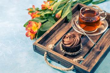 Picture of black tea, cake with cream