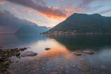 The lake shore and Peschiera Maraglio at sunset, Montisola, Iseo lake, Brescia province, Lombardy district, Italy