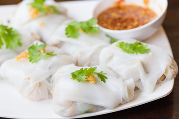 Rice noodle roll.vietnamese food, whit sauce in white plate
