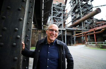 Egbert Bodmann of the Landscape Park Duisburg poses for a picture in front of a blast furnace of a former steel plant of Germany's rust-belt city Duisburg