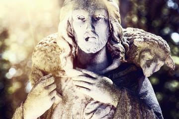 Ancient statue of Jesus Christ - the Good Shepherd. Retro filter.