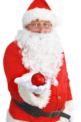 Real Santa Claus holding christmas ball, isolated on white background
