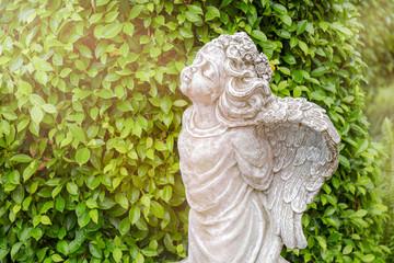 Little angels / View of sculpture of little angel in the garden.
