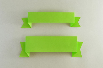 two strips of green paper