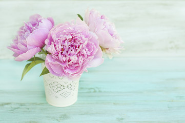 Greeting card, a bouquet of peonies on a turquoise background, space for text