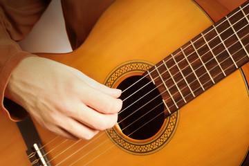 Tuinposter Muziek Classical guitar hands strings. Acoustic guitar player