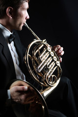 Photo sur Aluminium Musique French horn player. Classical musician playing horn