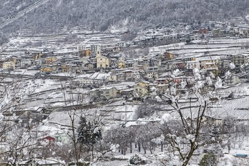 View of the village of Montagna in Valtellina in winter. Montagna, Valtellina, Lombardy, italy. Europe