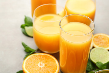 Glasses of fresh orange juice on table, closeup
