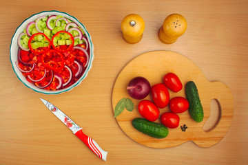 salad of cucumber and tomato cooking, salt and pepper
