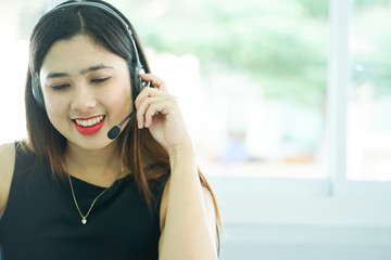 close up headphone asian help desk woman response answer customer or partner in operation room for business and technology concept.