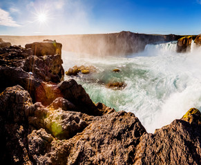 Nice views of the bright sunlit powerful Godafoss cascade. Location Skjalfandafljot river, Iceland, Europe. Beauty world.