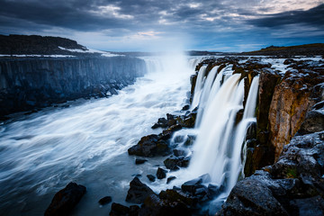 Rapid flow of water powerful Selfoss cascade. Popular tourist attraction.