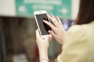 Close up, Beautiful female hands holding a mobile phone, indoor