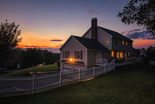 Colonial house sunset