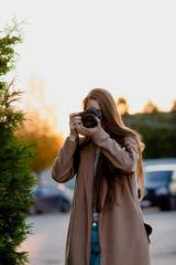 Woman photographer taking a shoot
