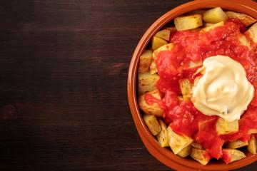 Patatas bravas, Spanish potato dish, overhead closeup shot