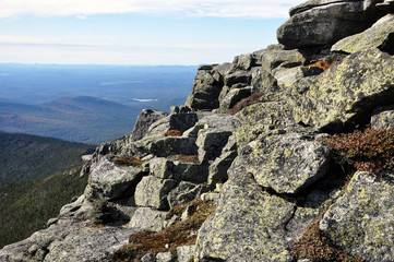 Rocks and Adirondack Mountains view from top of Whiteface Mountain in fall, New York State, USA.