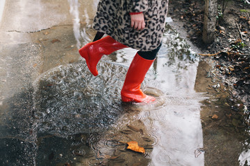 Woman standing in the puddle