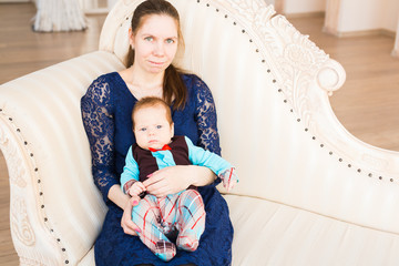 Adorable Caucasian baby with his mother. Portrait of a three months old baby boy