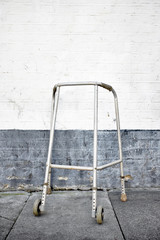 A walking frame left by a wall