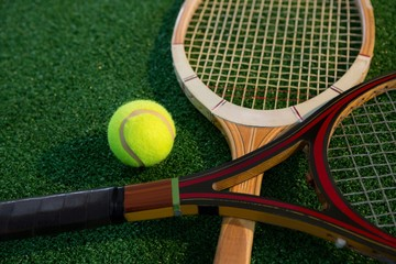 Close up of wooden racket with tennis ball