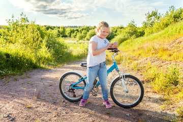 Smiling little girl on a bicycle