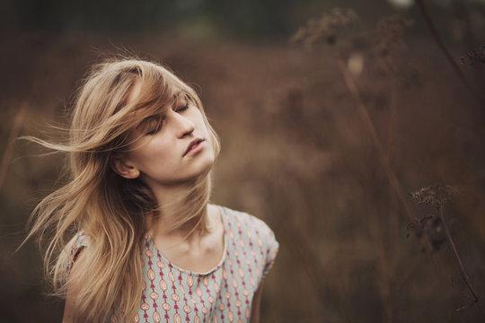Portrait of wind-blown looked female