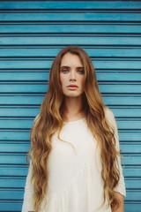 Beautiful Bohemian Woman in front of Blue Garage Door