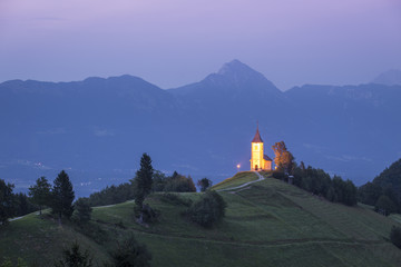 The iconic Jamik church, with Mount Triglav on the background. Jamnik, Kranj, Upper Carniola, Slovenia.