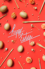 Happy Eastern text with decorations and eggs on red/orange background