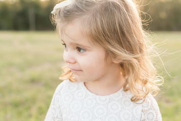 A Young Girl Looks Away From The Camera
