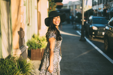 Smiling Young Woman In Sun Hat Outside Shopping Mall