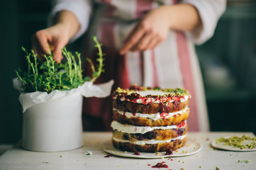Delicious cake; naked cake with berries and whipped cream decorated with mint leaves