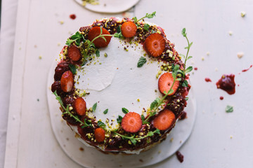 Delicious cake; naked cake with strawberries decorated with mint leaves