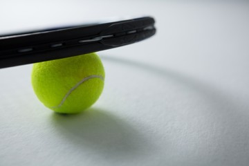 Cropped image of tennis racket with ball