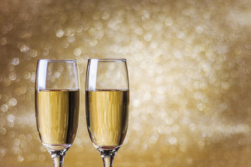 Toast champagne, new year, golden bokeh background