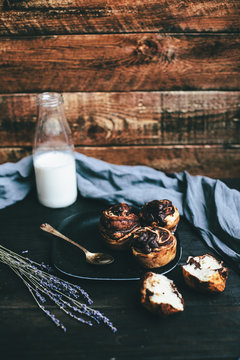 chocolate buns with a bottle of milk